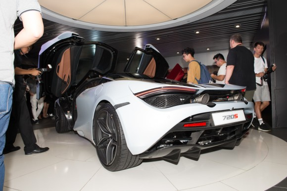 People from the media pour over the McLaren 720S at the Wanchai showroom for its Hong Kong launch on June 29, 2017. (Bill Cox/Epoch Times)