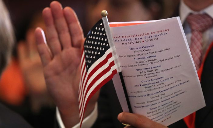 Immigrants become new American citizens during a naturalization ceremony on Ellis Island on May 27, 2016 in New York City. (John Moore/Getty Images)