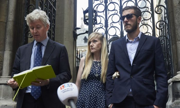 A spokesperson for the parents of terminally-ill, 10-month-old Charlie Gard, Chris Gard and Connie Yates delivers a statement to the media outside the High Court in London on July 10, 2017. (NIKLAS HALLEN/AFP/Getty Images)
