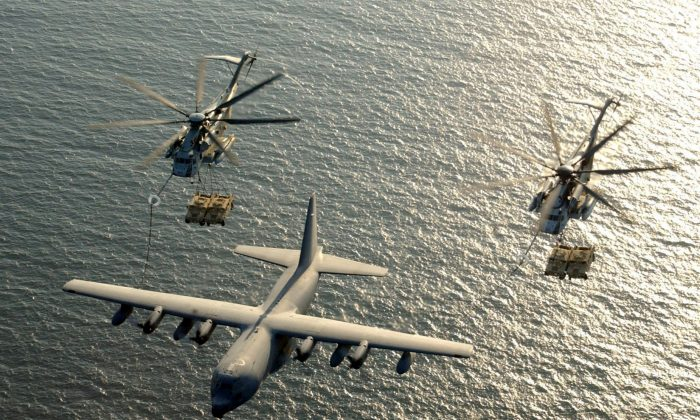 Two U.S. Marine Corps CH-53E Super Stallion helicopters receive fuel from a KC-130 Hercules over the Gulf of Aden January 1, 2003. (U.S. Marine Corps/Cpl. Paula M. Fitzgerald/Handout/File Photo via Reuters)
