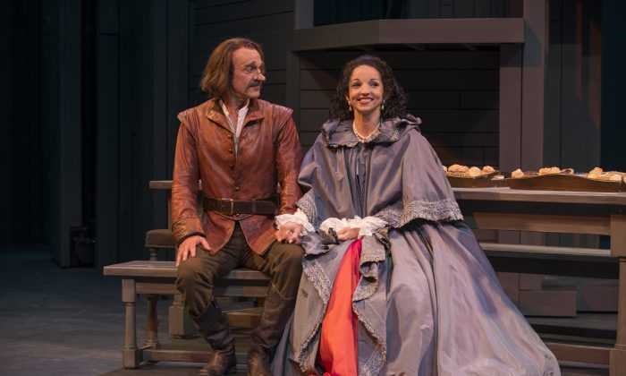 Cyrano (James Ridge) listens in anticipation to hear who his cousin Roxane (Laura Rook) truly loves. (Michael Brosilow)