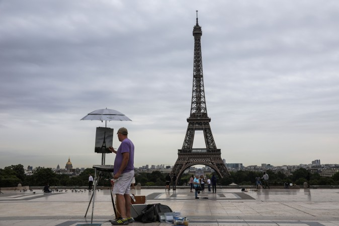 An artist paints the Eiffel Tower on the Trocadero Plaza in Paris on July 11, 2017. (LUDOVIC MARIN/AFP/Getty Images)