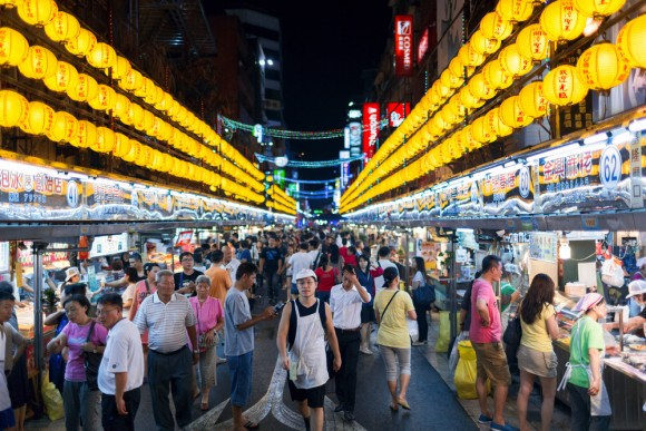 Every night, crowds flock to the famous Miaokou Night Market in Keelung City looking for some scrumptious eats.  (Yevgen Belich/Shutterstock)