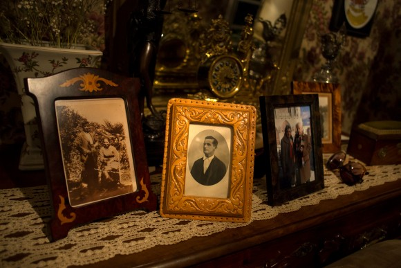A portrait of Rafael Martinez (C), one of those were killed by forces of the dictator Francisco Franco in 1936 in the area known as La Pedraja, is seen among other portraits at family home in Briviesca, Spain, June 23, 2017. (Reuters/Juan Medina)