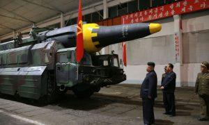 China Says to Enforce UN Curbs on North Korea as Trump Praises Cohesion
