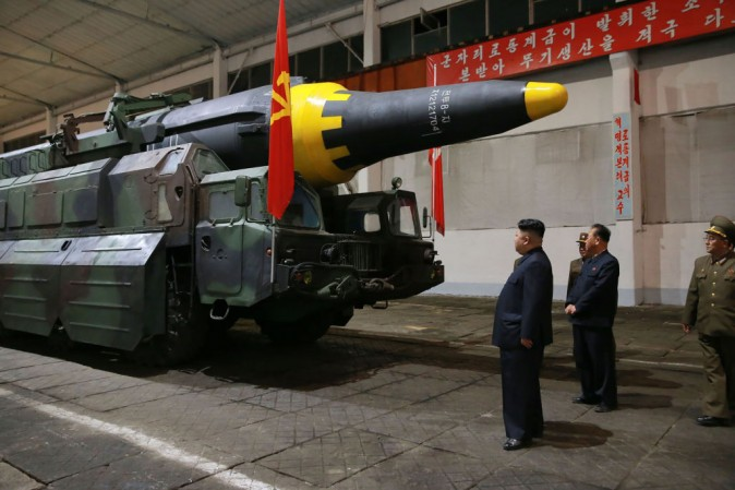 North Korean leader Kim Jong Un (L) inspects a Hwasong-12 strategic ballistic rocket at an undisclosed location in this picture released by North Korean state media on May 15.  (STR/AFP/Getty Images)
