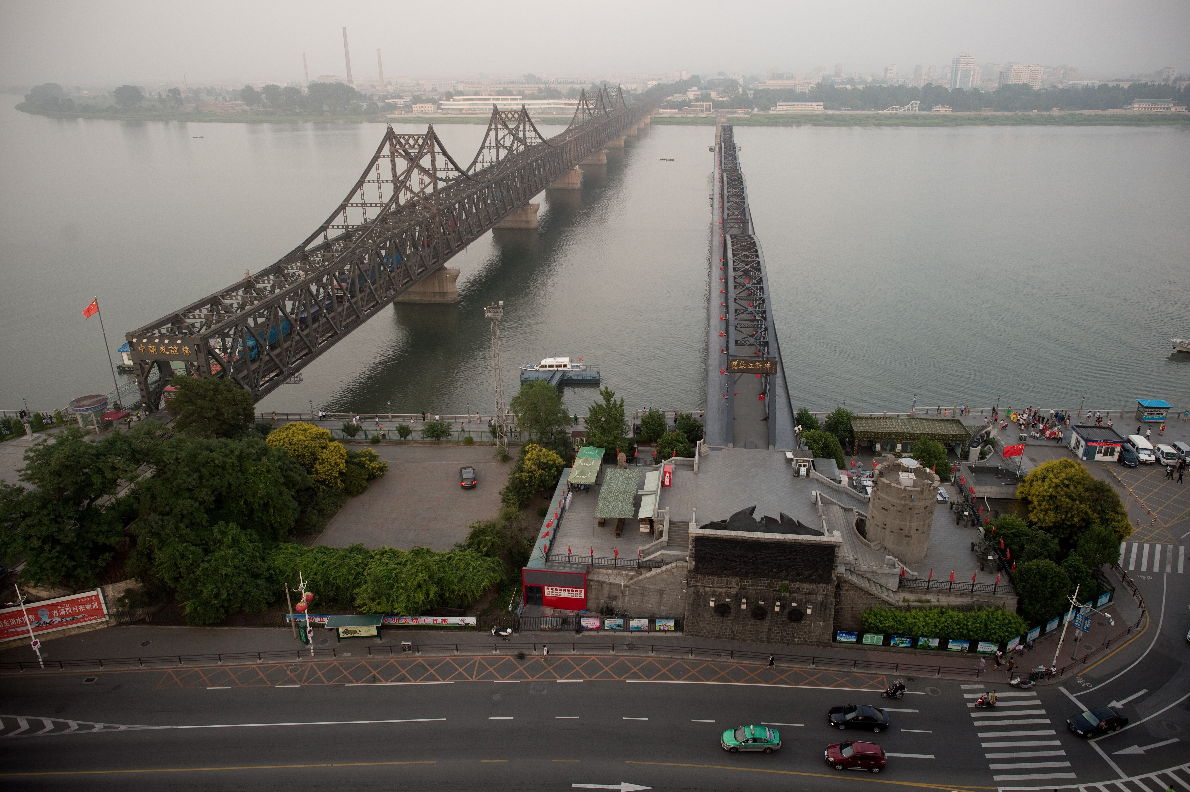 Bridges connecting the Chinese city of Dandong and the North Korean city of Sinuiju on July 5.  (NICOLAS ASFOURI/AFP/Getty Images)