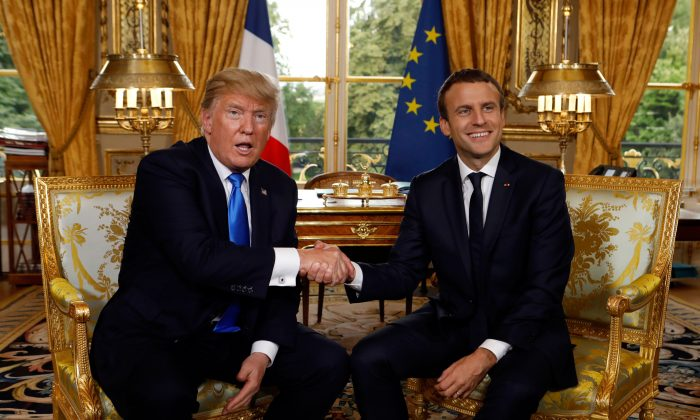 President Donald Trump (L) shakes hands with French president Emmanuel Macron at the Elysee Palace in paris on July 13. (KEVIN LAMARQUE/AFP/Getty Images)