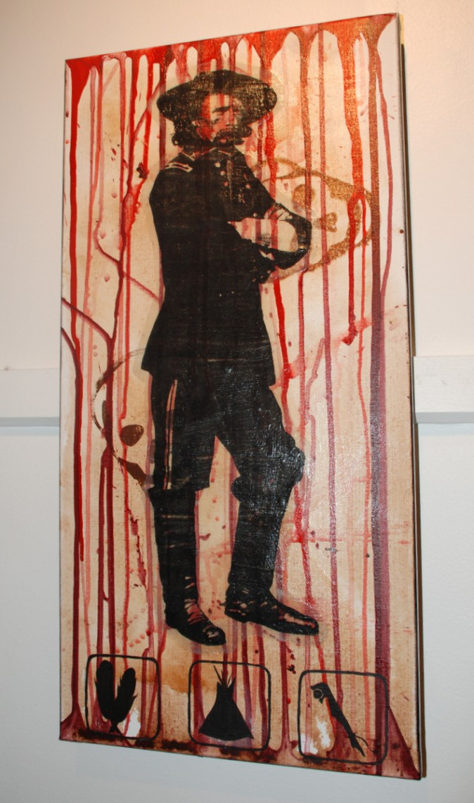 Picture of defaced George Armstrong Custer covered with blood. (Myriam Moran copyright 2014)