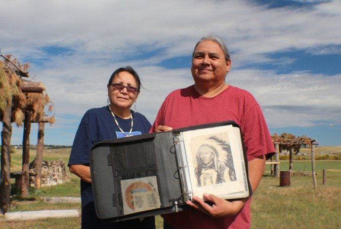 Emerson Elk and his wife Jerilyn holding the photograph of Howard Bad Bear his Great Grand Father who died at the Massacre of Wounded Knee. (Myriam Moran copyright 2014)