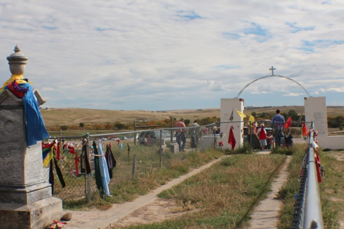 The Wounded Knee Cemetery with ribbons placed by tribal members as a sign of their respect and prayers for the dead. (Myriam Moran copyright 2014)