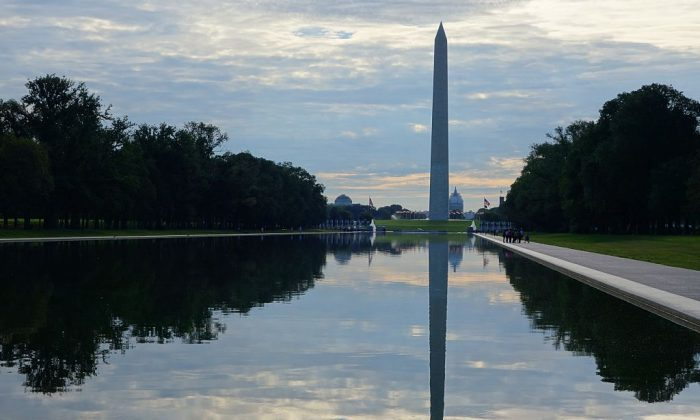 The Washington Monument and US Capitol are seen beyond the waters of the reflecting pool on the National Mall in Washington, DC. (KAREN BLEIER/AFP/Getty Images)
