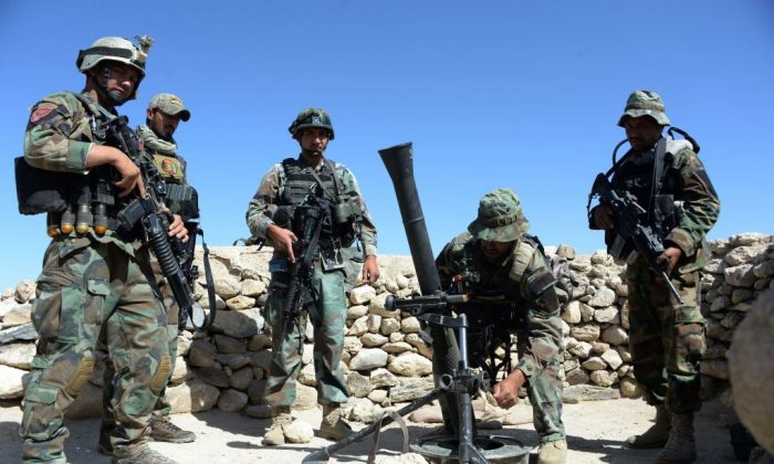 Afghan commandos prepare to launch mortar shells on an ISIS terrorist stronghold in Achin district of Nangarhar, eastern Afghanistan on April 14, 2017.  (NOORULLAH SHIRZADA/AFP/Getty Images)