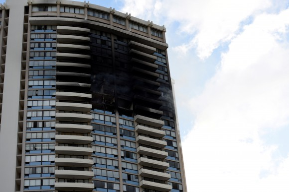 The  Marco Polo apartment building after a fire broke out in it in Honolulu, Hawaii, July 14, 2017.  (Reuters/Hugh Gentry)