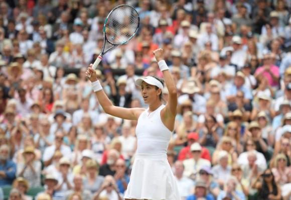 Spain's Garbine Muguruza celebrates winning the semi final match against Slovakia's Magdalena Rybarikova at Wimbledon in London, July 13, 2017. (Reuters/Toby Melville)