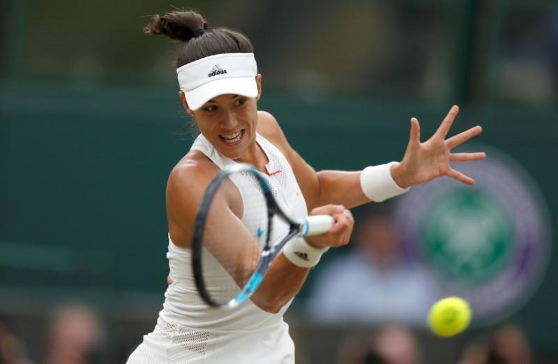 Tennis - Wimbledon - London, Britain - July 15, 2017   Spain's Garbine Muguruza in action during the final against Venus Williams of the U.S.   REUTERS/Matthew Childs