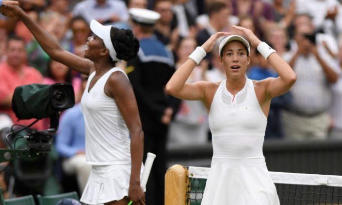 Spain's Garbine Muguruza celebrates winning the final against Venus Williams of the U.S. on  July 15, 2017. (REUTERS/Tony O'Brien)