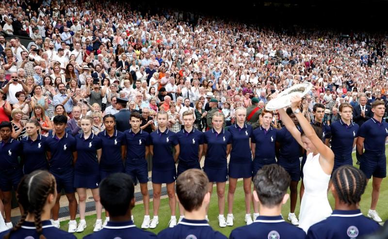 Tennis - Wimbledon - London, Britain - July 15, 2017   Spain's Garbine Muguruza poses with the trophy as she celebrates winning the final against Venus Williams of the U.S.     REUTERS/Matthew Childs