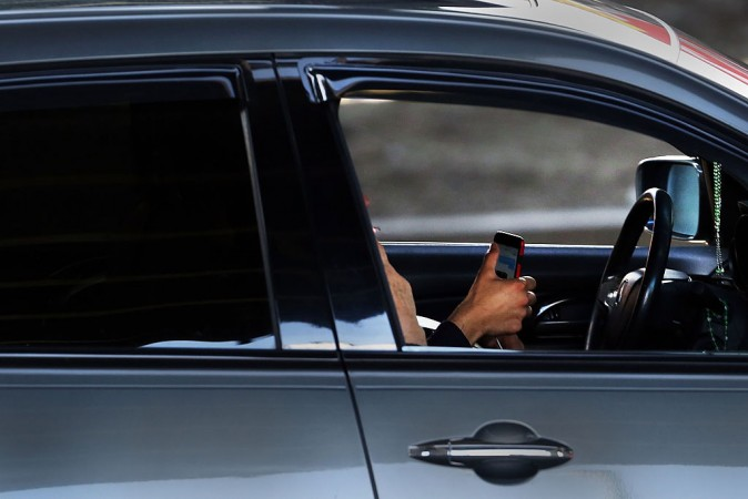 A driver uses a phone while behind the wheel of a car on in New York City. (file, Spencer Platt/Getty Images)