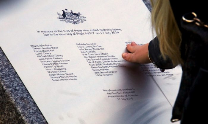 A relative of an Australian victim of Malaysia Airlines jet MH17 touches a memorial that was unveiled outside Parliament House in Canberra, Australia, July 17, 2015.   (Reuters/David Gray/File photo)