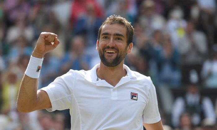 Croatia's Marin Cilic celebrates winning the semi final match against Sam Querrey of the U.S. at Wimbledon in London, July 14, 2017. (Reuters/Toby Melville)