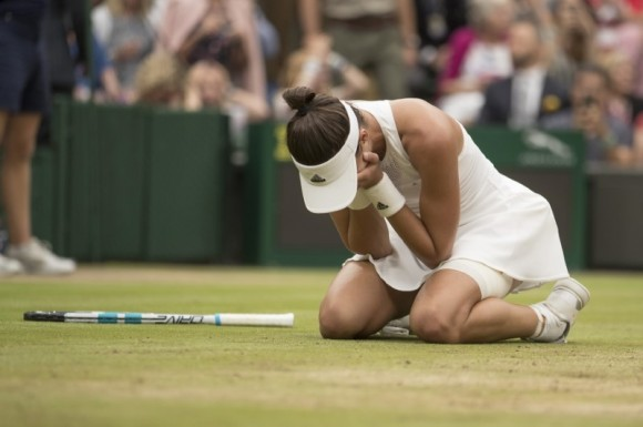 Garbine Muguruza celebrates match point during her women's finals match against Venus Williams on day twelve at the All England Lawn Tennis and Croquet Club, Jul 15, 2017. (Susan Mullane/USA Today Sports)