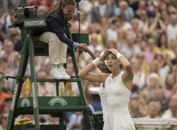 Garbine Muguruza celebrates match point during her women's finals match against Venus Williams on day twelve at the  All England Lawn Tennis and Croquet Club, in London, Jul 15, 2017. (Susan Mullane/USA Today Sports)