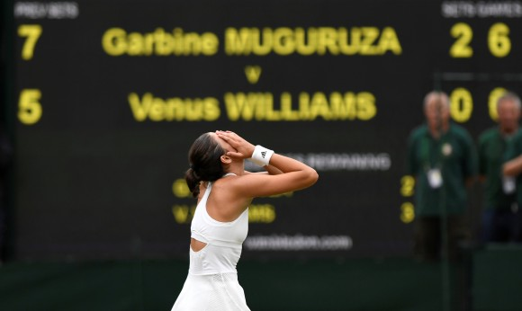 Spain's Garbine Muguruza celebrates winning the final against Venus Williams of the U.S, at Wimbledon in London, July 15, 2017.  (Reuters/Tony O'Brien)