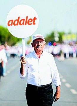 Kemal Kilicdaroglu, leader of Turkey's Republican People's Party (CHP), holds a placard that reads