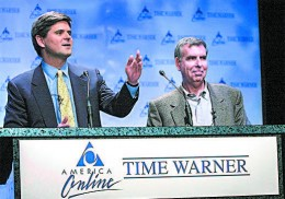 AOL Chairman Steve Case (L) and Time Warner Chairman Gerald Levin announce their companies' merger on Jan. 10, 2000. The $164 billion merger failure is one of the symbols of the 1990s tech bubble. Unrealistic dreams about the future pushed stock valuations to unsustainable valuations, until the bubble popped. (STAN HONDA/AFP/GETTY IMAGES)