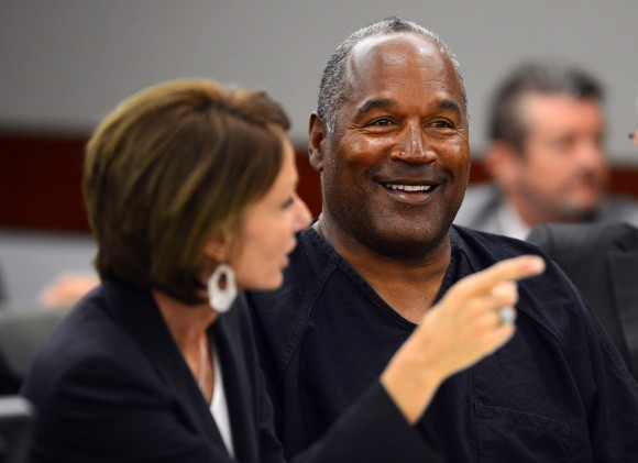 O.J. Simpson with his defense attorney Patricia Palm at the end of an evidentiary hearing in Clark County District Court on May 17, 2013 in Las Vegas, Nevada.  (Photo by Ethan Miller/Getty Images)