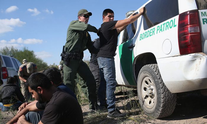 A U.S. Border Patrol officer body searches an undocumented immigrant after he illegally crossed the U.S.-Mexico border.  (Photo by John Moore/Getty Images)