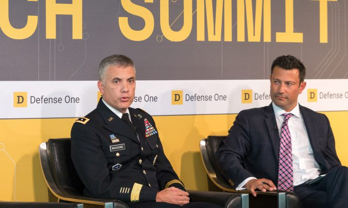 Lt. Gen. Paul Nakasone (L), the commander of the U.S. Army Cyber Command, is interviewed by Defense One Executive Editor Kevin Baron during the Defense One's annual summit in Washington, D.C on July 13. (Paul Huang/Epoch Times)