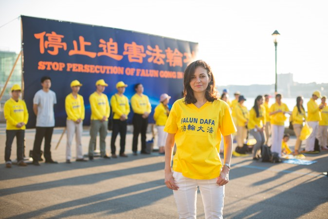 Cristina Oz with Falun Gong practitioners in front of Chinese Consulate in New York for a rally and candlelight vigil calling for an end to the persecution on July 16, 2017. (Benjamin Chasteen/The Epoch Times)