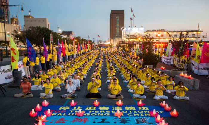 Hundreds of Falun Gong practitioners and supporters, hold a candlelight vigil in front of the Chinese Consulate in New York on July 16, 2017. The persecution, now entering its 18th year, began on July 20, 1999. (Benjamin Chasteen/The Epoch Times)