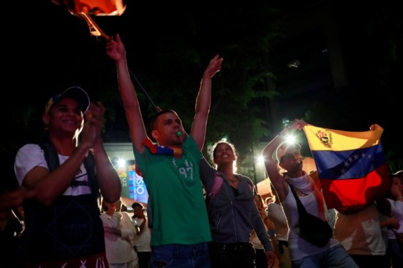 Opposition supporters react while waiting for results of the unofficial plebiscite against President Nicolas Maduro's government and his plan to rewrite the constitution, in Caracas, Venezuela July 16, 2017. (Reuters/Marco Bello)