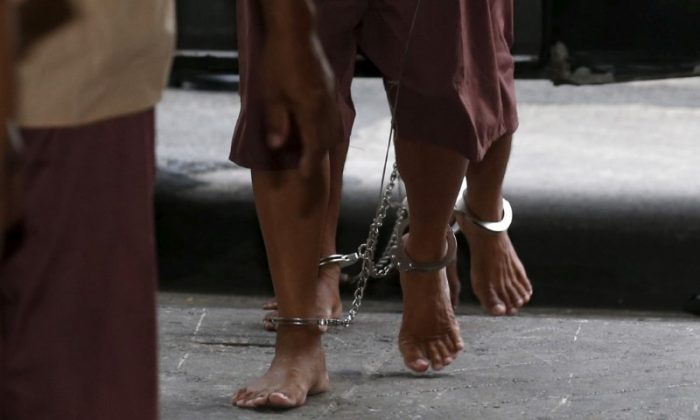 The shackled legs of suspected human traffickers are seen as they arrive for their trial at the criminal court in Bangkok, Thailand, March 15, 2016. (Reuters/Chaiwat Subprasom/File Photo)