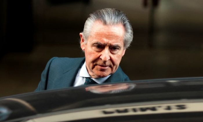 File photo: Miguel Blesa, former chairman of savings bank Caja Madrid, leaves the High Court in Madrid, Spain March 3, 2014. (Reuters/Sergio Perez/File photo)