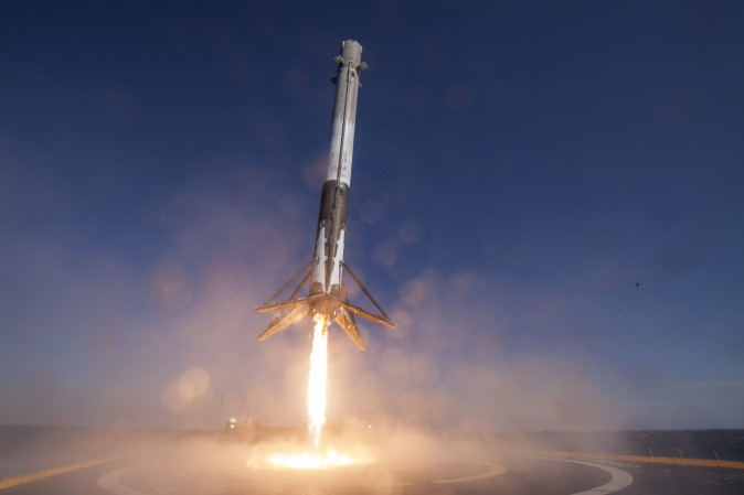 "In this handout provided by the National Aeronautics and Space Administration (NASA), SpaceX's Falcon 9 rocket makes its first successful upright landing on the ""Of Course I Still Love You"" droneship on April 8, 2016 some 200 miles off shore in the Atlantic Ocean, after launching from Cape Canaveral, Florida. (NASA via Getty Images)"