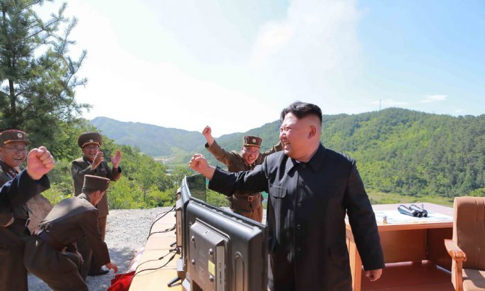 This picture taken and released on July 4, 2017 by North Korea's official Korean Central News Agency (KCNA) shows North Korean leader Kim Jong-Un (R) reacting after the test-fire of the intercontinental ballistic missile Hwasong-14 at an undisclosed location. North Korea declared on July 4 it had successfully tested its first intercontinental ballistic missile -- a watershed moment in its push to develop a nuclear weapon capable of hitting the mainland United States. (STR/AFP/Getty Images)