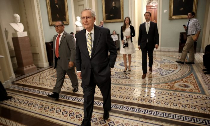 Senate Majority Leader Mitch McConnell walks to a meeting of Republican senators at the Capitol on July 13, 2017. (Win McNamee/Getty Images)