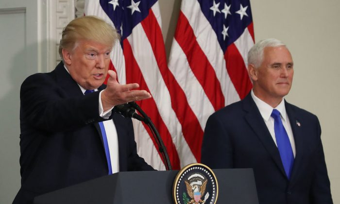 President Donald Trump speaks while flanked by US Vice President Mike Pence during the first meeting of the Presidential Advisory Commission on Election Integrity in the Eisenhower Executive Office Building, on July 19, 2017 in Washington, DC.  (Photo by Mark Wilson/Getty Images)