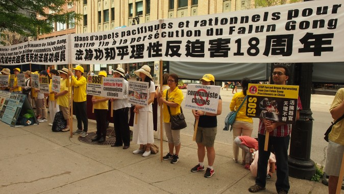 Falun Gong adherents hold an event in front of the Chinese Consulate in Montreal on July 19, 2017, to mark 18 years since the persecution of their spiritual practice was launched by the Chinese regime on July 20, 1999. (Nathalie Dieul/The Epoch Times)