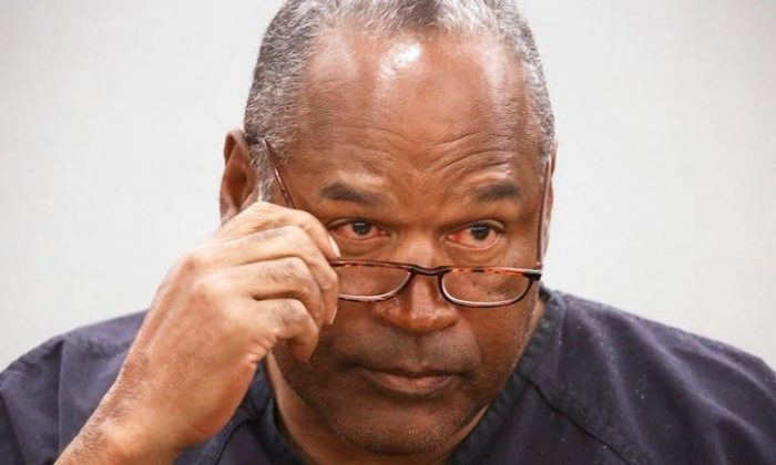 File Photo: O.J. Simpson takes his glasses off during his evidentiary hearing testimony in Clark County District Court in Las Vegas, Nevada, U.S. on May 15, 2013. (Reuters/Jeff Scheid/Pool/File Photo)
