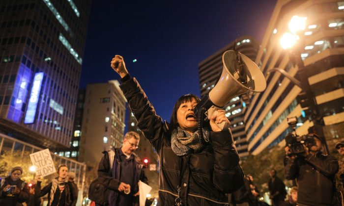 Yvette Felarca of Oakland speaks to the crowd on the second night of demonstrations following a Staten Island, New York grand jury's decision not to indict a police officer in the chokehold death of Eric Garner on December 4, 2014 in Oakland, California.  (Elijah Nouvelage/Getty Images)