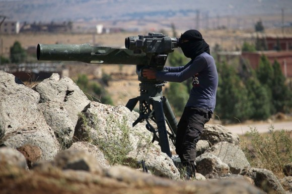 An opposition fighter looks for government forces' positions in Syria's southwestern Quneitra province on June 28, 2017. (MOHAMAD ABAZEED/AFP/Getty Images)
