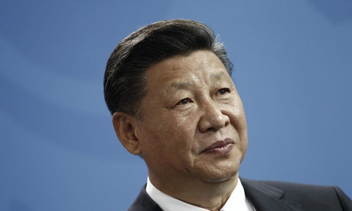 """Chinese leader Xi Jinping speak to the press during a press statement at the German chancellery in Berlin on July 5, 2017. On July 19, Xi called on petition work officials to """"make 'every possible effort' to solve public grievances."""" (Michele Tantussi/Getty Images)"""