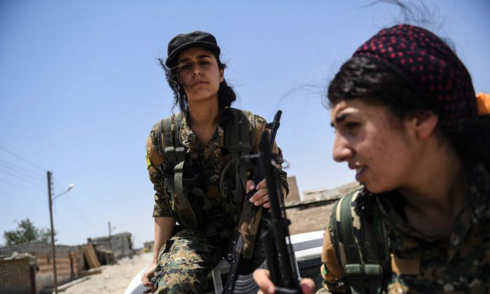Members of the Women's Protection Units (YPJ) arrive on the frontline on the eastern outskirts of Raqqa on July 18, 2017.  (BULENT KILIC/AFP/Getty Images)