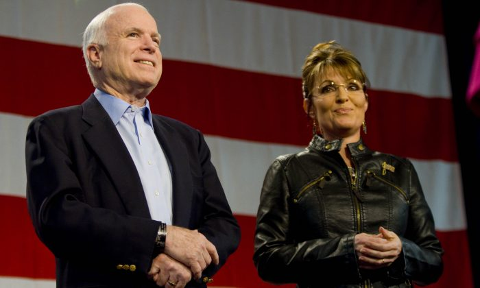 U.S. Sen. John McCain (R-AZ) and former Alaska Gov. Sarah Palin (L) at a campaign rally at Pima County Fairgrounds on March 26, 2010 in Tucson, Arizona. (Darren Hauck/Getty Images)