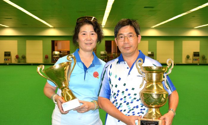 Danna Chiu (L) of Tuen Mun Sports Association and CT Wong of Hong Kong Football Club proudly display their first National Indoor Singles trophy after winning in the finals last Saturday, July 15, 2017. (Stephanie Worth)